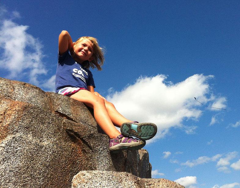 Girl atop boulder